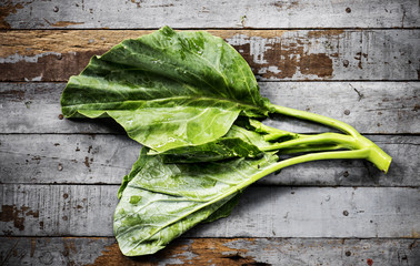 Aerial view of fresh collard chinese kale on wooden background