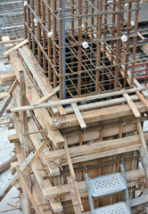 Concrete column steel reinforcement bar at the construction site fabricated by workers.It will be closed by timber form work before concreting work start.