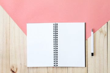 Still life, business, office supplies or education concept : Top view image of open notebook with blank pages on wooden background, ready for adding or mock up