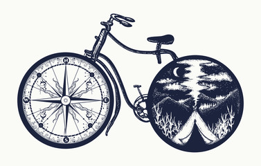 Bicycle tattoo art. Symbol of travel, tourism, adventure, camping. Compass and mountains in bicycle wheels t-shirt design