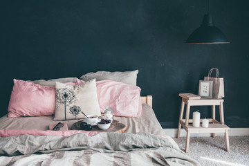 Black and pink bedroom in loft style