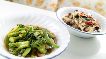 homemade stir-fried vegetable combination and stir-fried crab and mushroom combination