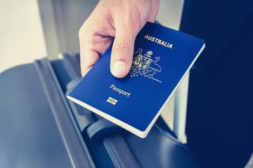Hands giving passport - vintage tone