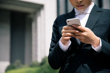 young woman looking smart phone.