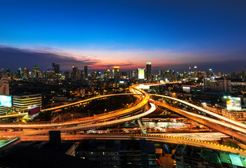 Poster Bangkok Road roundabout with car lots in Bangkok,Thailand.Beautiful street in Bangkok.The light on the road at night and the city in Bangkok, Thailand .Lights of cars on the road. And views of city lights at