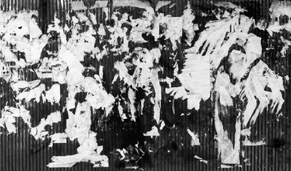 Grunge texture. Ragged paper on the wall. Black-and-white image.