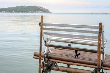 wooden bench or chair near sea beach