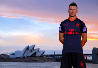 Soccer player Laurent Koscielny from English Premier League club Arsenal wears the 'Third Kit' for the 2017/2018 season as he stands in front of the Sydney Opera House in Sydney Harbour