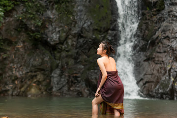 Daily life of rural women in Asia,Was bathing in a waterfall