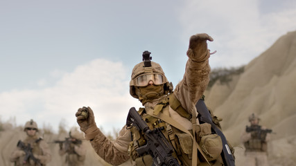 Soldier Throwing a Grenade during Combat in the Desert.