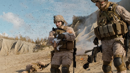 Soldier Carrying a Baby and Running Away from the Explosion While other Members of Squad Covering Them During Battle in the Desert.