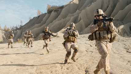 Squad of Fully Equipped, Armed Soldiers Running in the Desert. Show Motion.