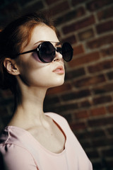 Beautiful young woman with glasses on the street