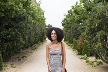 Portrait of smiling woman walking in a park