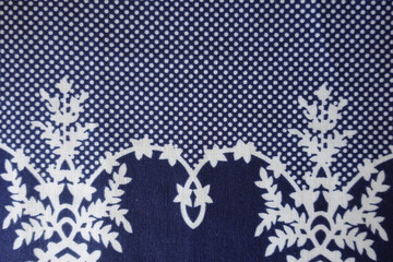 Sophisticated old fashioned pattern on blue fabric