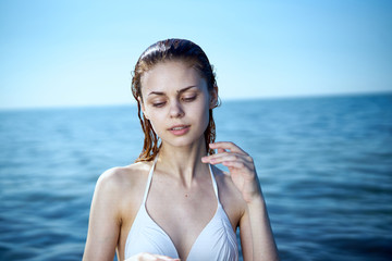 Beautiful young woman is resting on the sea, vacation, summer, beach