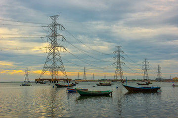 High voltage power pole in the sea and sky background.transmission tower.Electricity pylon.
