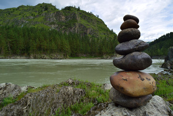 Stone pyramid near Katun river in Altay mountains. Chemal, Altay Republic, Siberia, Russia.