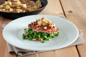 pork chop with apple, green beans and pecan nuts