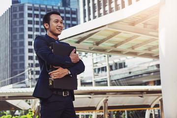businessman hugging a briefcase, powerful businessman
