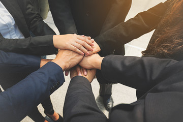 Group of business people joining hands. Team work concept.