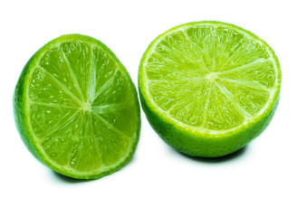 Sliced ripe juicy lime close-up on white
