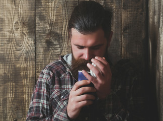 Bearded brutal man opening blue plastic cup
