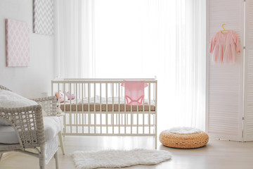 Modern interior design of baby room with crib