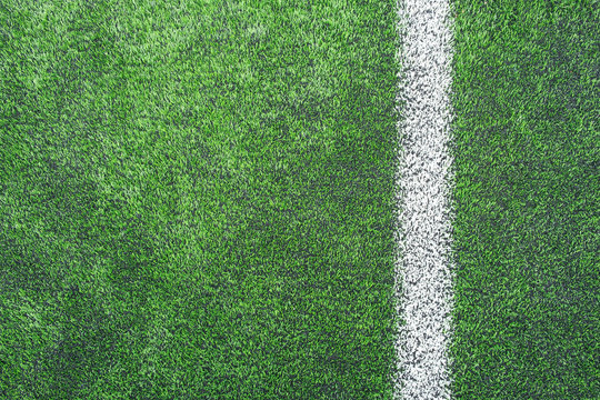 surface of Artificial turf with White corner line on the green football/soccer field from top view for background
