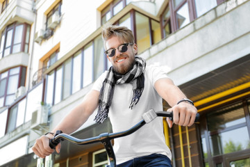 Young man with bicycle outdoors