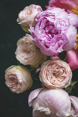 Peonies and bombastic roses bouquet. Shabby chic pastel colored wedding bouquet. Closeup view, selective focus