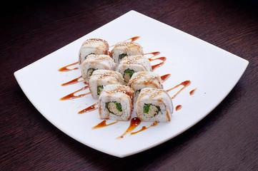 Set of sushi maki dragon on white plate. Japanese food isolated on background