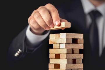 Businessman Building Up Tower, Business Concept