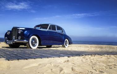 Beautiful blue retro car on the coast