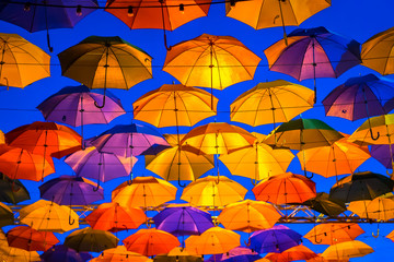Umbrellas in the night sky