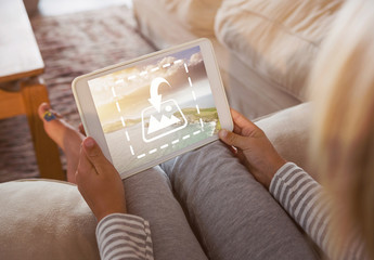 User with Tablet on Couch Mockup 1