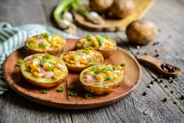 Potato boats filled with corn, ham, cheese and green onion