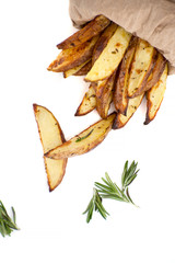 "Slices of baked potato ""country style"" with rosemary on a white background.."