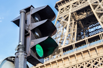 Traffic light on the background of the Eiffel Tower in Paris. France.