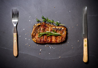 Grilled calf's cutlet with cutlery