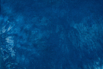 Blue dye on cotton cloth, Dyed indigo fabric background and textured
