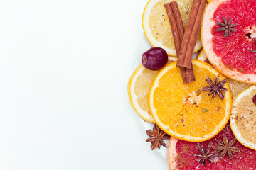 slices of oranges, lemons and grapefruits on vintage white table. Citrus fruit background. healthy eating with natural vitamins. Top view with copy space