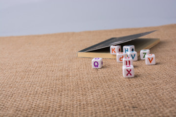 Colorful alphabet letter cubes out of sack