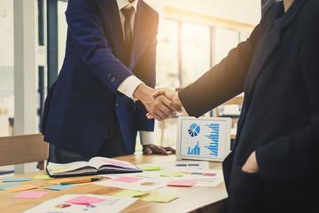 Business financial partnership meeting concept. Image businessmans handshake. Successful businessmen handshaking after good deal. Agreement concept.