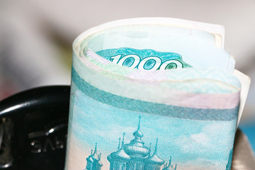 Collapsed casually in a tube paper denominations Russian face value of one thousand rubles