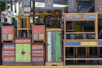 Old vintage shabby furniture, wood texture in Ubud market, island Bali, Indonesia