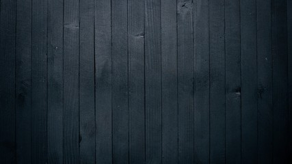 Wooden black texture surface. Top view. Free space for your text.