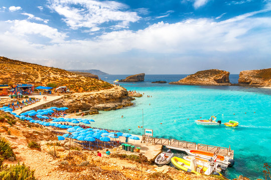 Turquoise lagoon with beach near the Comino island between the islands of Malta and Gozo in the Mediterranean Sea, Europe.