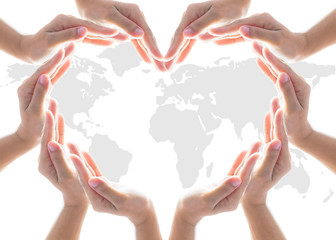 International cooperative, charity aid, friendship and world protection concept with heart collaborative hands