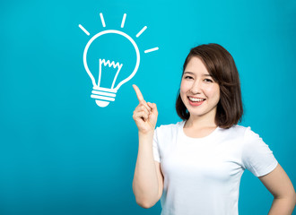 idea and inspiration. young woman and electric bulb symbol illustration.